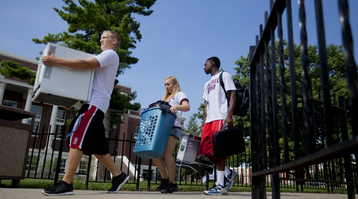 Students hefting items towards their new on-campus homes for Move-in Mania